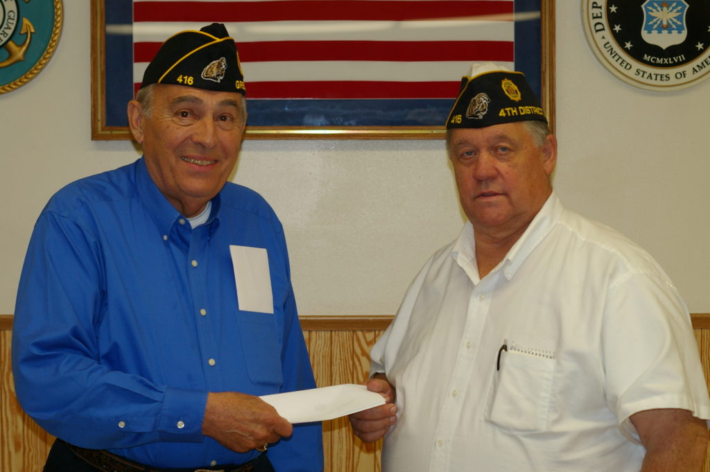 Donation from George Vignyvich from Ewald, shown with Tim Baranzyk